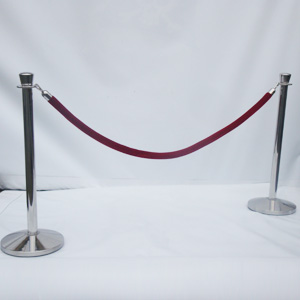 Chrome pole and red velvet rope